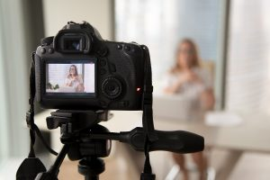 Taking a video of a woman using an slr