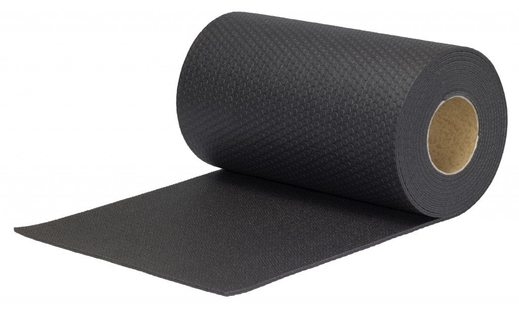 Rolled black rubber mat in white background