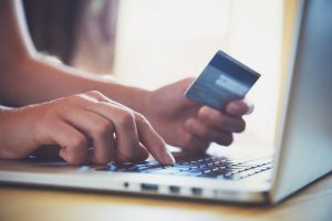 Hand holding credit card online shopping