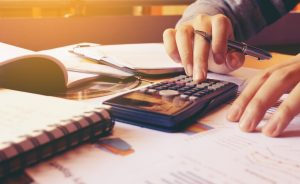 Bookkeeper calculating finances