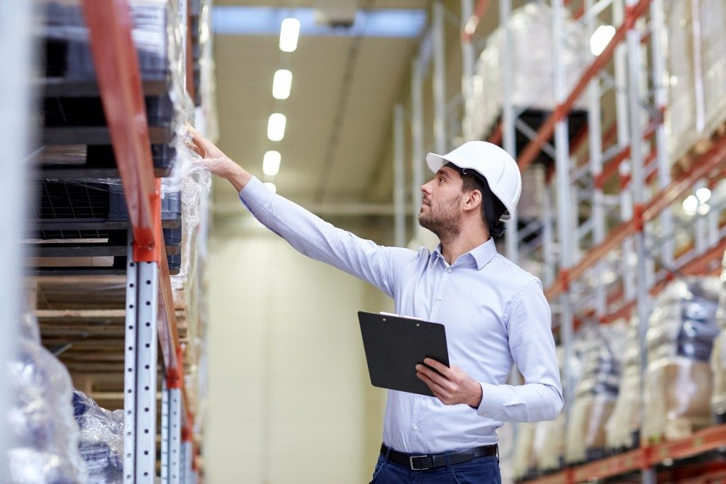 Manager checking items at the warehouse