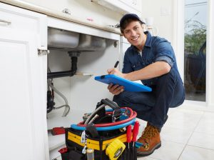 a plumber working