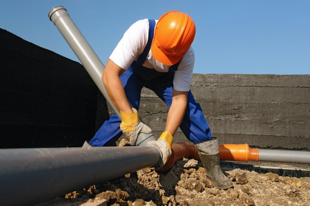 sewage pipes being maintained