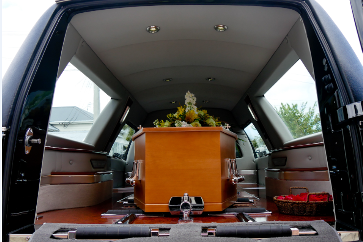 casket inside of car