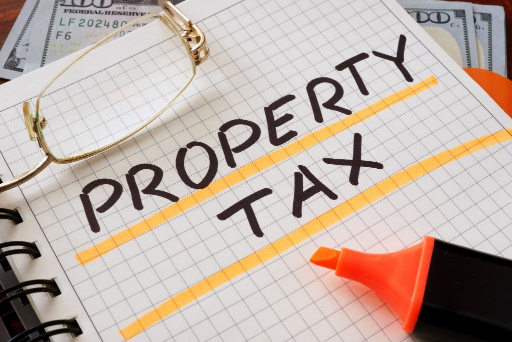 Notebook with property tax sign on a table. Business concept.