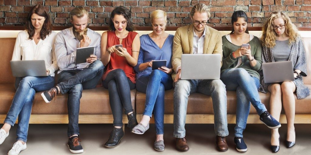 Group of people with their gadgets