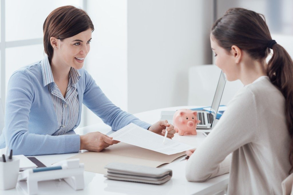 Financial advisor talking to her client