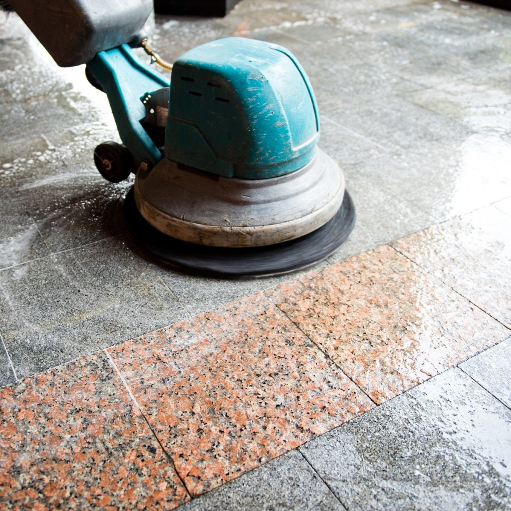 industrial scrubber being used in cleaning the floor