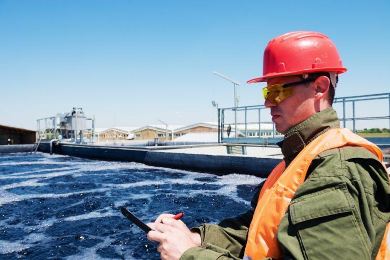 man monitoring the wastewater treatment facility