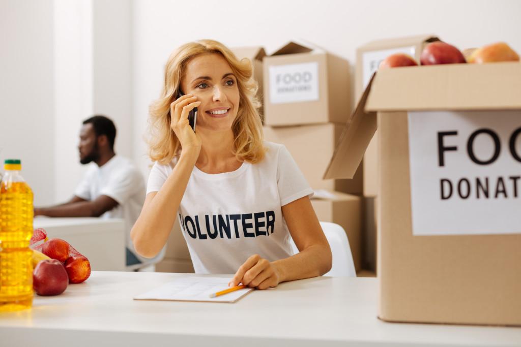 Female volunteer talking on the phone