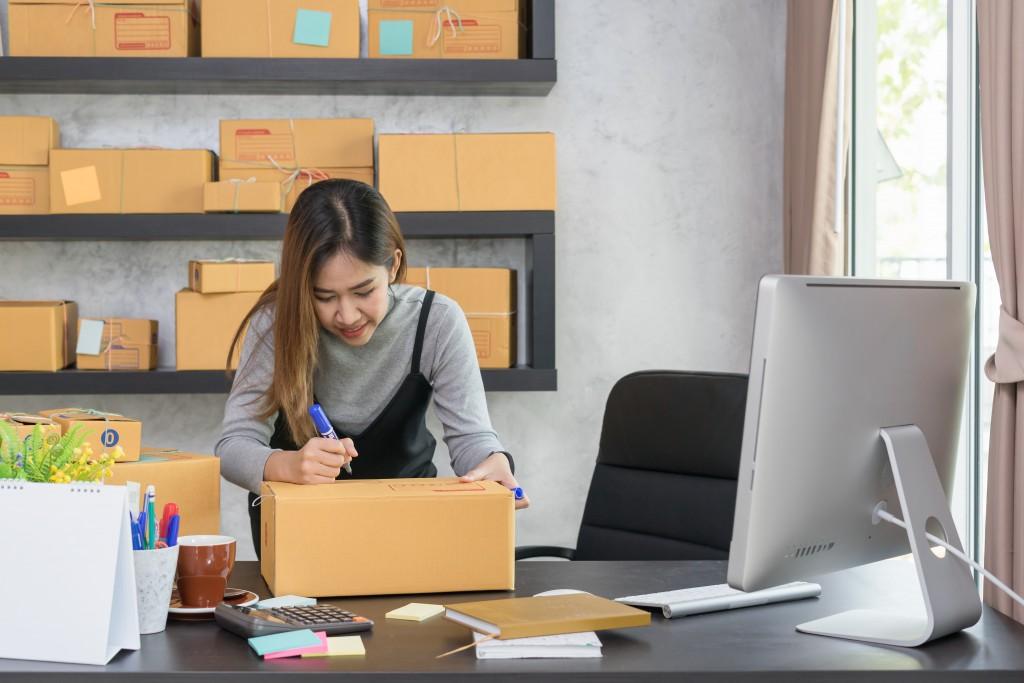 business woman marking a box
